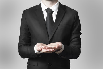 businessman begging gesture black suit