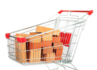 Bricks in shopping cart isolated on white
