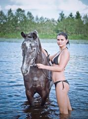 girl bathe horse in a river
