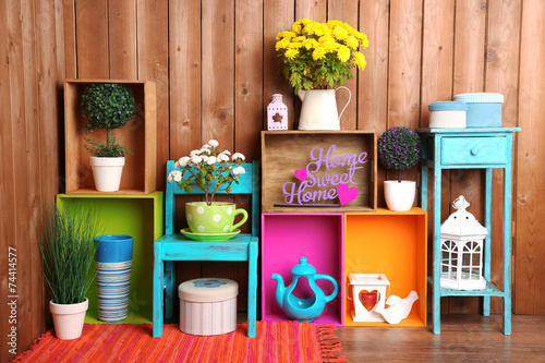 Leinwanddruck Bild Beautiful colorful shelves with different home related objects
