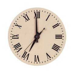 Vintage clock face showing seven o'clock