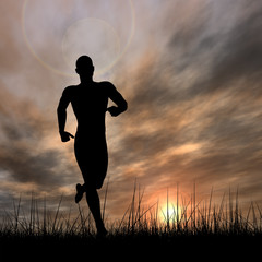 Conceptual man running in grass at sunset