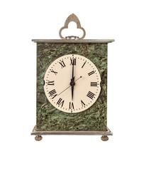 Mantel clock showing six o'clock