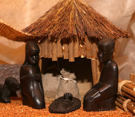 Nativity scene with Holy Family in a manger in Africa