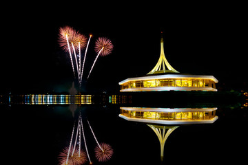 fireworks on the black sky background with reflection on water a