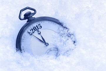 Pocket watch in snow, New Year 2015 greeting card