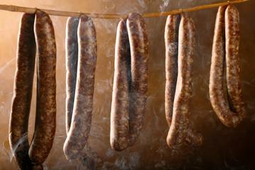 Smoked sausage in a haze of smoke