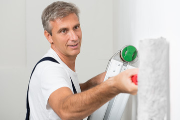 Satisfied Painter Painting Wall