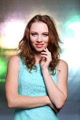 Portrait of beautiful young female on bright background