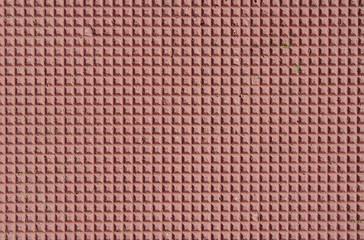 Red decorative tile  closeup