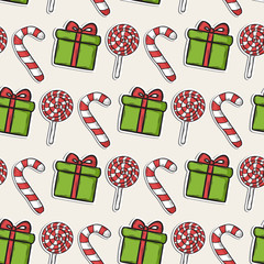 Christmas pattern with candy and green gifts