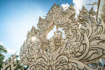 Art sculpture by national artist in white temple Thailand