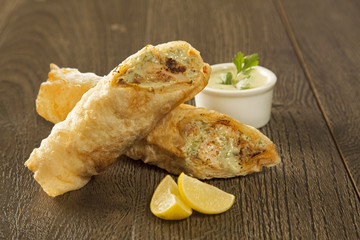 Traditional kebab paratha roll tikka wrap served on a plate with