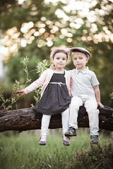 boy and girl sitting on tree