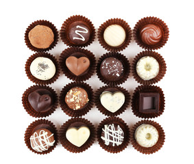 Delicious chocolate candies isolated on white