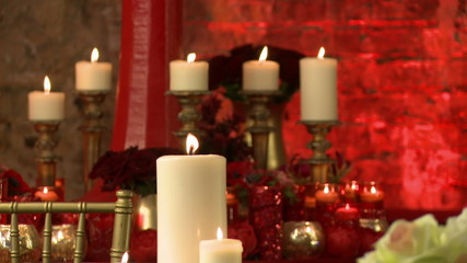 Lighted candles and red roses as interior decor