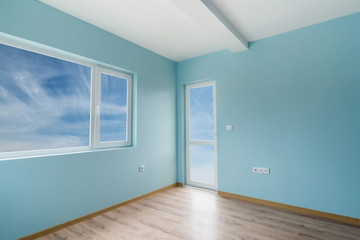 Empty blue room with windows and a door includes clipping path