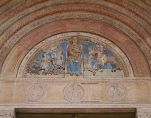 The colourful madonno relief of the cathedral in Verona in Italy