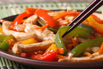 chicken with peppers, carrots macro and chopsticks, horizontal