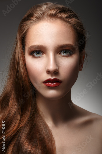 Plakát, Obraz beautiful woman with perfect skin and long hair on a grey backgr