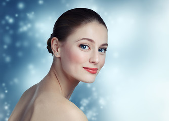 Portrait of a beautiful young girl model with clean skin and blu