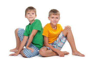 Two young boys sit together