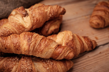 Some croissants on a wooden surface