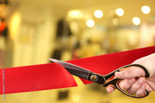Leinwandbild Motiv Grand opening, cutting red ribbon