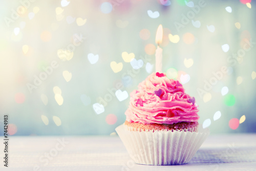 Foto op Plexiglas Dessert Delicious birthday cupcake on wooden table