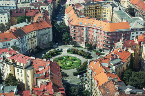 Foto op Canvas Praag Circular square with old houses and beautiful lawn