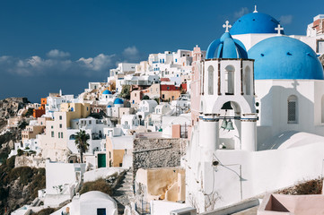 Cityscape of Oia with the bell tower in Santorini, Greece.
