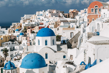 Santorini cityscape with the blue dome in Oia, Greece.