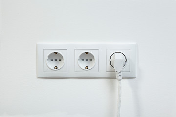 White power plug plugged in a electric socket