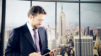Man in office doing business with tablet in New York