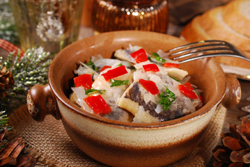 herring salad for christmas on wooden table