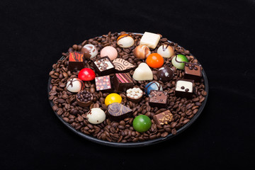 Set of a various chocolate pralines and coffee beans