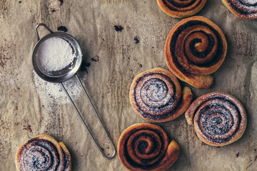 sweet rolls with cinnamon, chocolate and powdered sugar