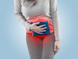 Woman with both palm around belly area.