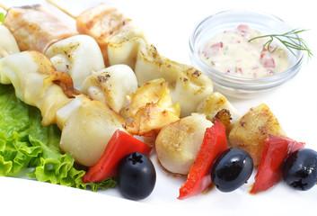 Skewers with vegetables, fish and calamari