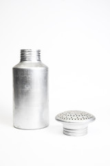 Metal salt shaker with the lid taken off