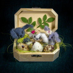 Artistic compositions with knitted animals. Hare.