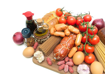 fresh food, spices, olive oil and sauce on a cutting board on a