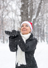 Woman catches hands snowflakes for Christmas