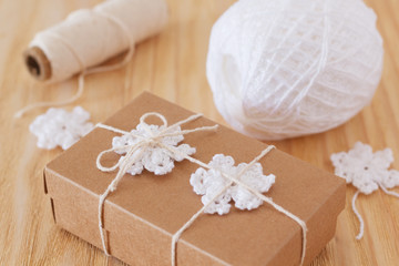 White crochet snowflakes for Christmas decoration of box gift