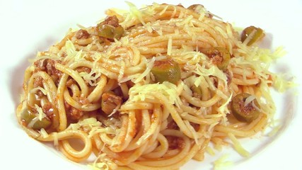 Italian cuisine. Pasta with meat sauce and green olives