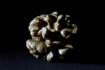 Large Wrinkled Edible Seed of a Walnut Isolated on Black