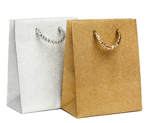 golden and silver gift bags on white background