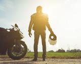 Fototapety biker with his bike