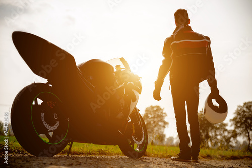 biker with his bike - 74433346