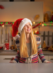Portrait of happy teenager girl in christmas decorated kitchen